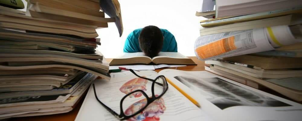 College Student Very tired Studying