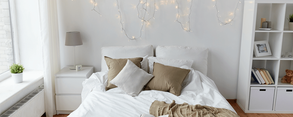 christmas lights on wall and a bed that can be bought with mattress deals online
