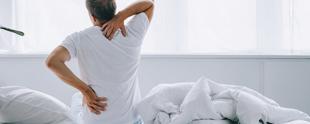 man waking with back pain